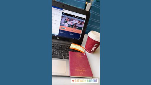 Passport, laptop and coffee on train